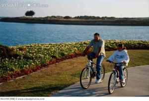 father_and_daughter_bikeriding_father_and_daughter_riding_bikes_at_marina_park_in_ventura_califo_BA3708